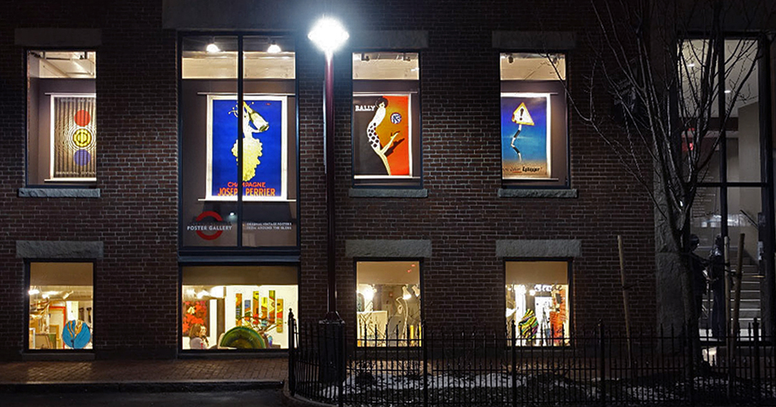 External view of gallery showing posters at night