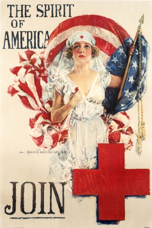 Young Red Cross nurse reaches out to the viewer, flag behind; red, blue, white